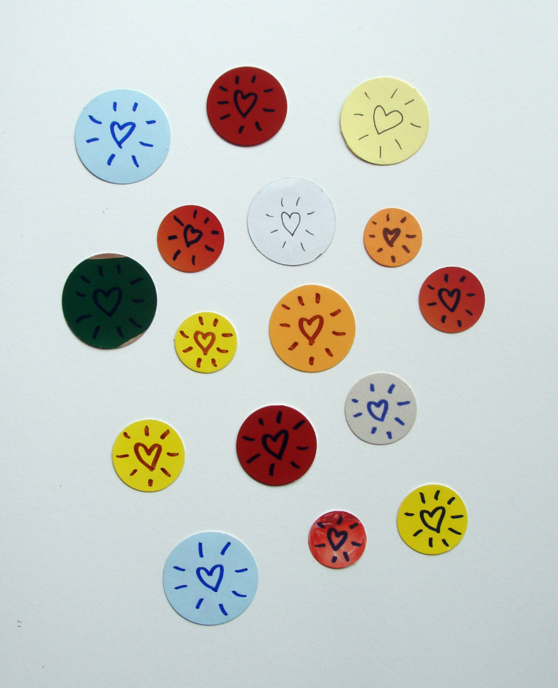 16 round tokens with radiating hearts