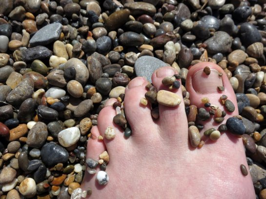 Sara's foot on pebble beach